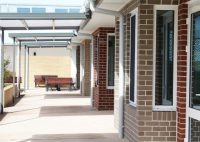 Anglicare Aged Care exterior covered walking area outside rooms